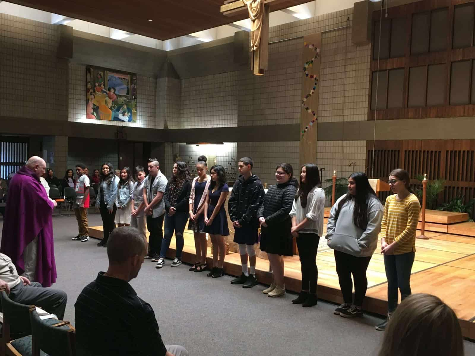 Blessing of Confirmation candidates by Fr. Steve Adrian on Sunday, March 8, at the 10:15 am Mass